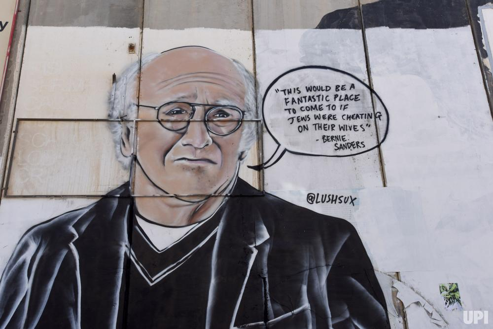 Political-graffiti-appears-on-separation-wall-in-Bethlehem_6_1